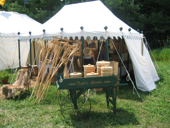 Tent example with cart selling goods in front of it