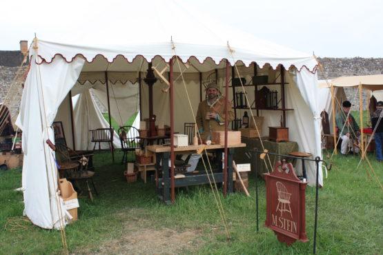Sign seller, roman wave tent trim