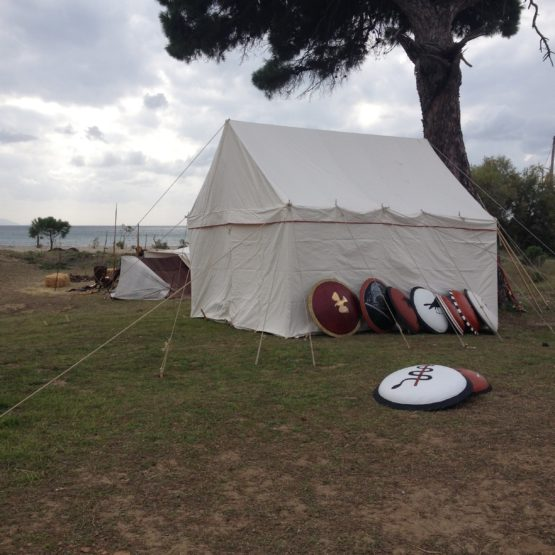 White canvas tent with a closed up door