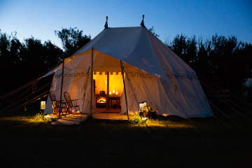 white tent with lit interior
