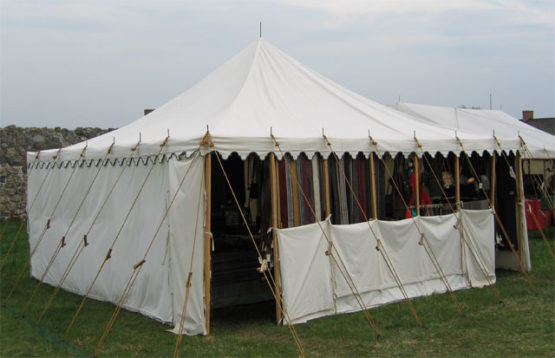 square canvas tent with a half-wall in front
