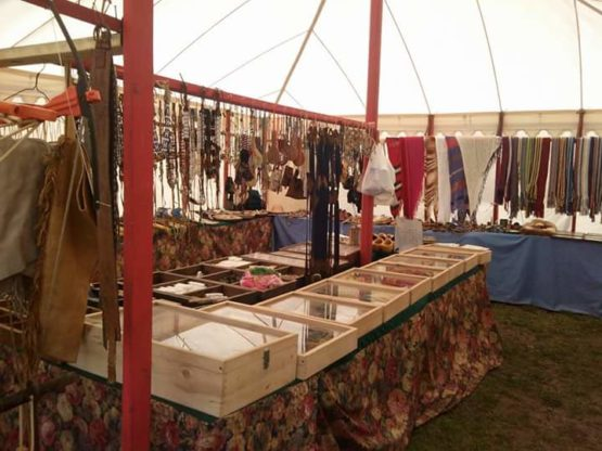 insode of a white canvas tent with bead display