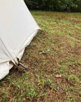 White canvas tent and metal stakes