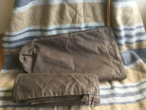 oilskin bag & tarp on blanket