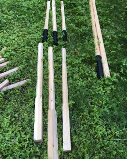 wooden poles, divided in half with a metal sleeve