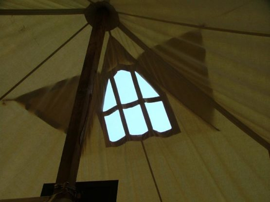 window at the top of a canvas tent roof
