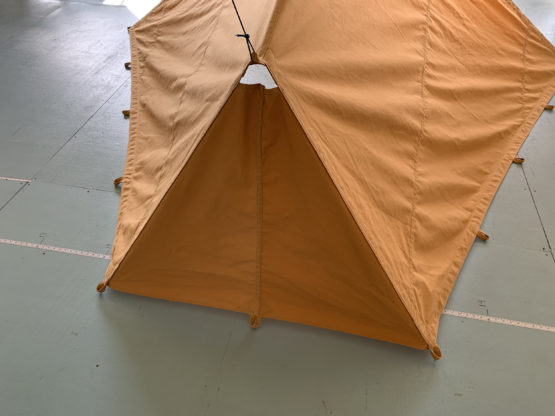 Back of tan tent