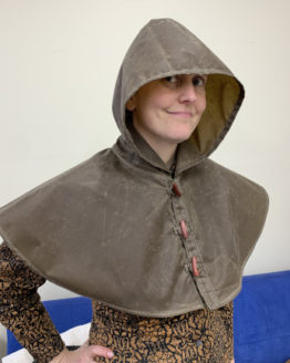 Person wearing a brown oilskin hood