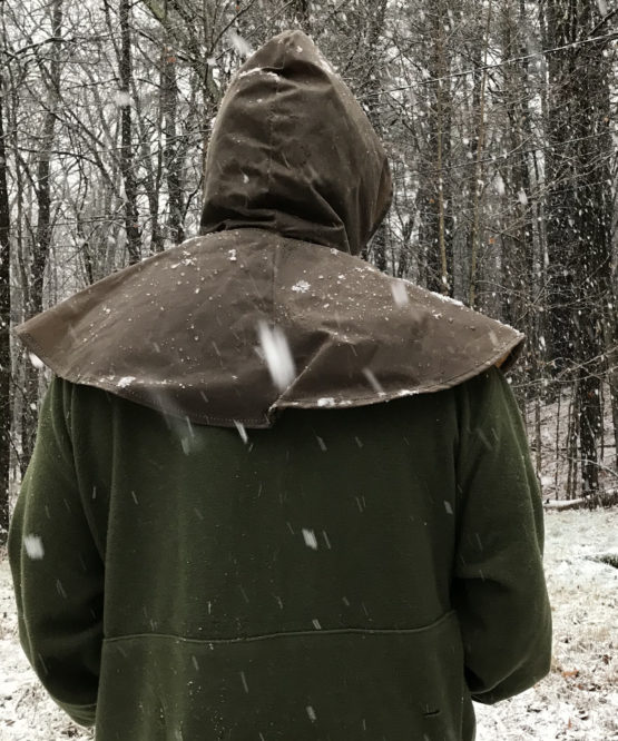 Back view of a man wearing a brown oilskin hood